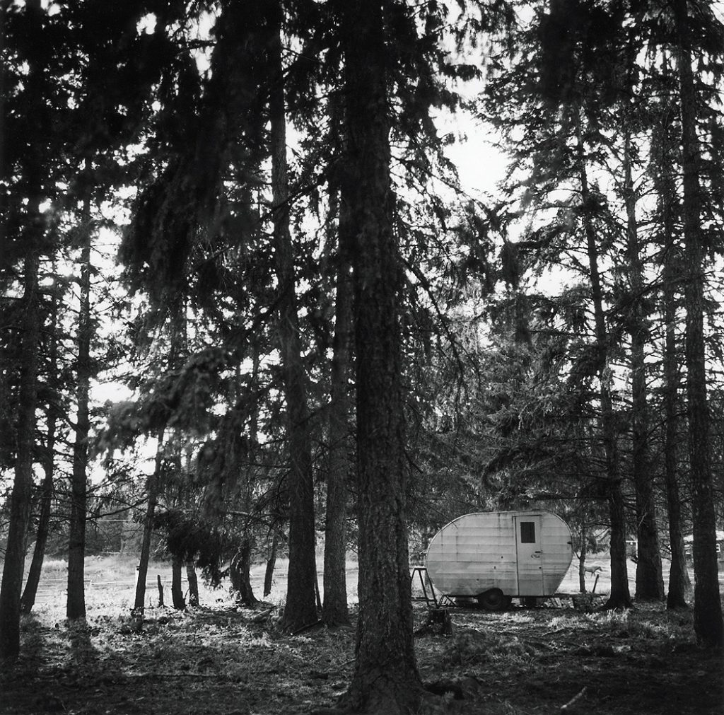 Lincoln Clarkes Photographs: Trailer in forest, Salmon Arm, British Columbia 1995