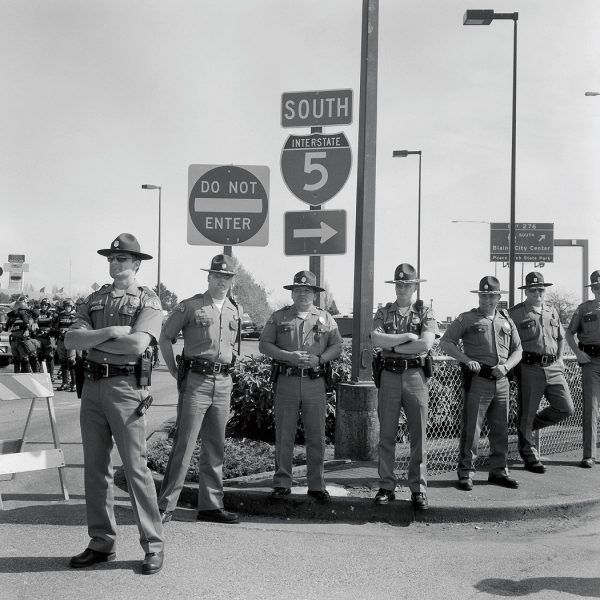 Lincoln Clarkes Photographs: State Troopers as Free Trade protesters shut down U.S. border, Peace Arch 2001