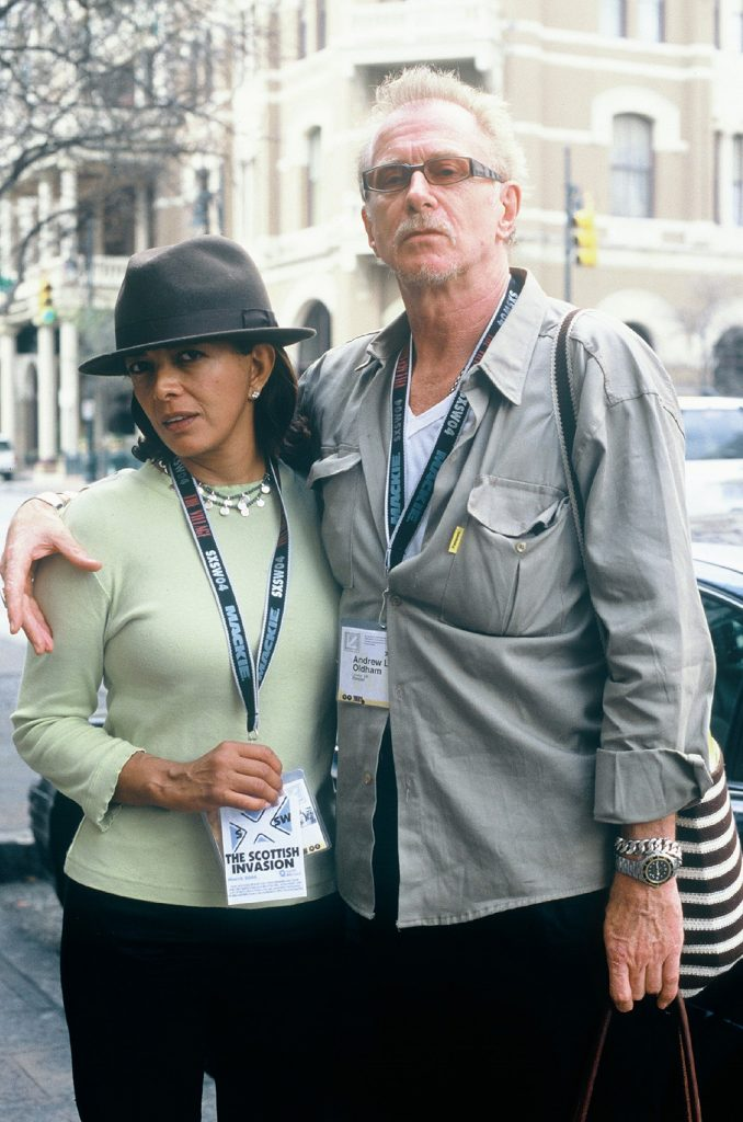 Lincoln Clarkes Photographs: Andrew Loog Oldham & wife Esther, Austin Texas 2004